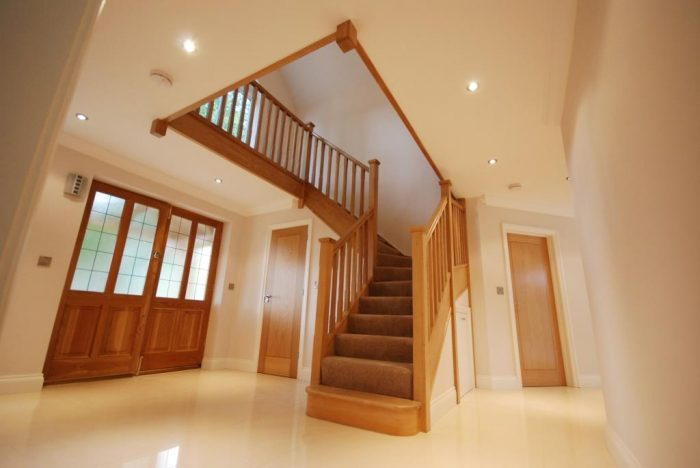 Large hall and galleried landing with oak staircase