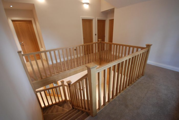 Large galleried landing with oak staircase