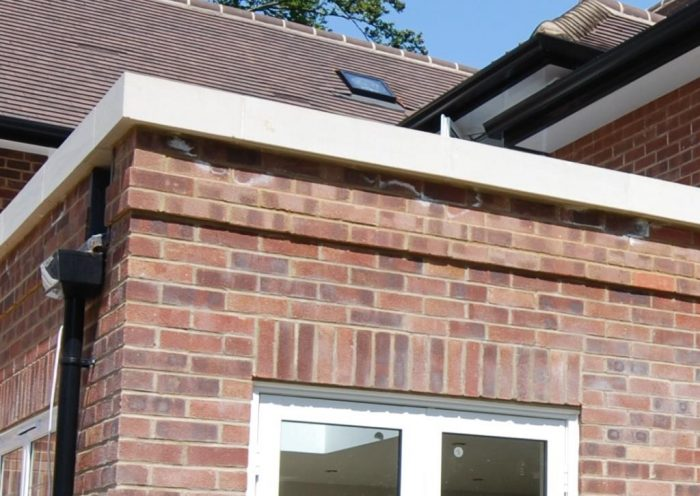 Orangery style extension with stone capped parapet roof
