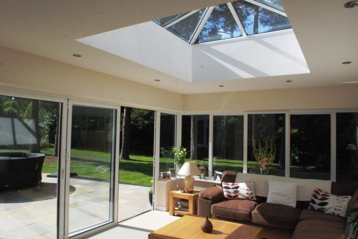 Orangery style extension with minimalist corner post and roof lantern