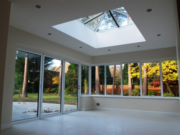 Part two storey part single storey extensions in pyrford surrey