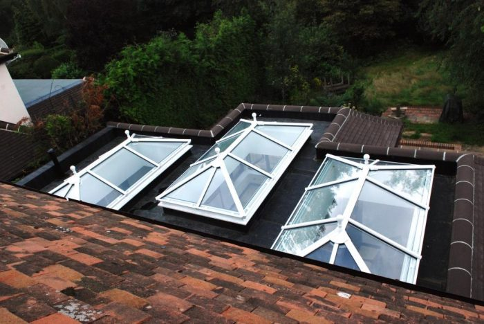Roof lanterns in kitchen/family/dining space from outside