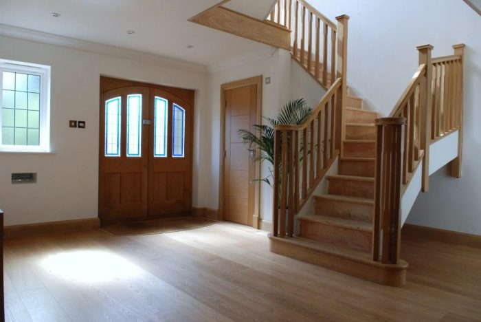 Master hall with feature oak staircase over two floors with vaulted ceiling