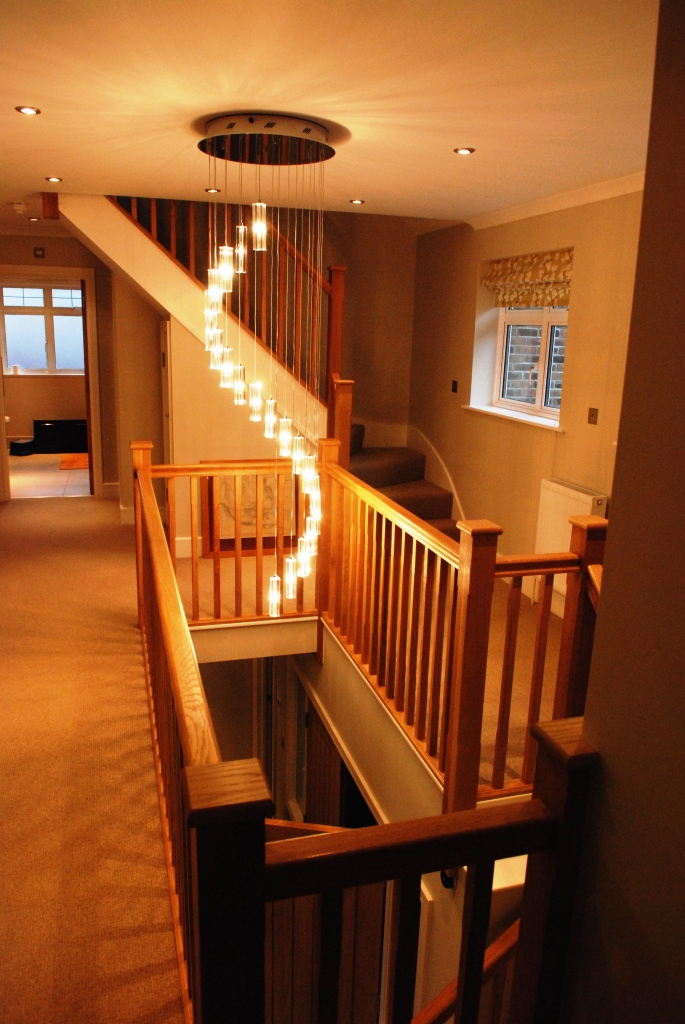 Oak staircase and galleried landing with feature light over