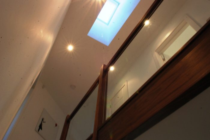 Roof light over first floor landing provides daylight to hall below and an interesting visual feature